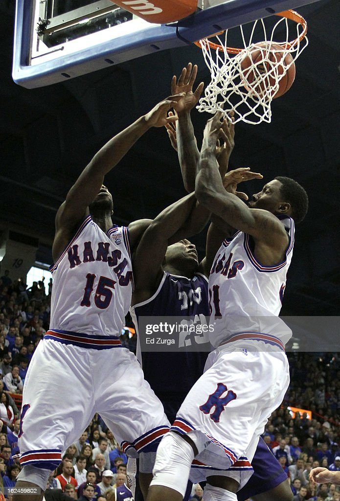 Elijah Johnson #15 and Jamari Traylor #31 of the Kansas Jayhawks battle for a rebound against Devonta Abron #23 of the TCU Horned Frogs at Allen Field House on February 23, 2013 in Lawrence, Kansas. Kansas won 74-48.