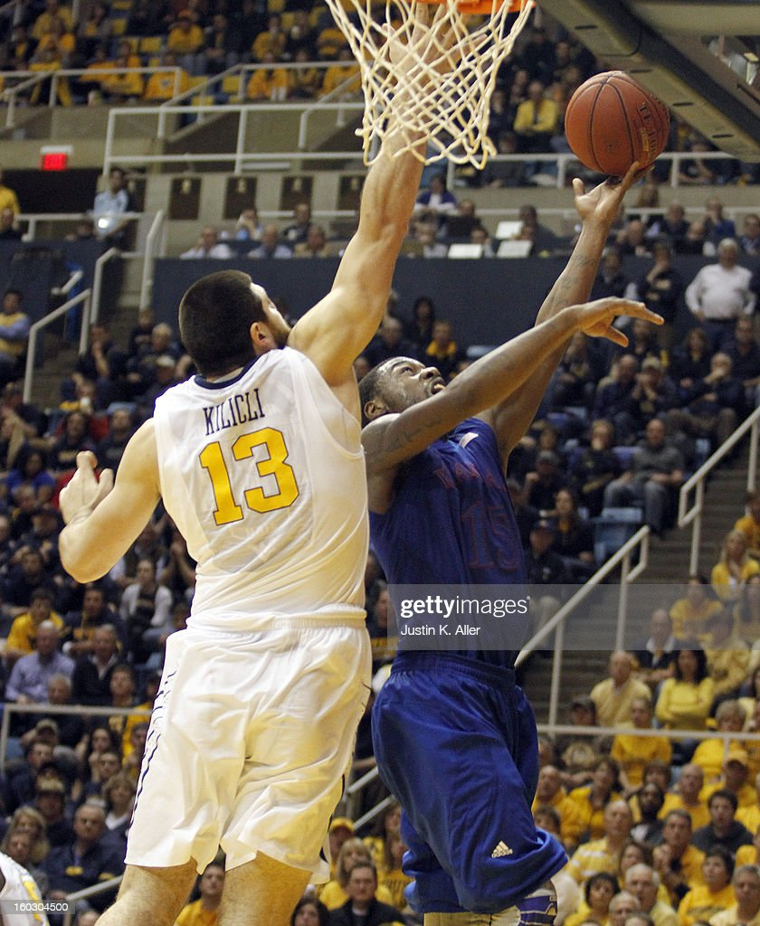 Elijah Johnson #15 of the Kansas Jayhawks attempts a shot against Deniz Kilicli #13 of the West Virginia Mountaineers at the WVU Coliseum on January 28, 2013 in Morgantown, West Virginia. The Jayhawks defeated WVU