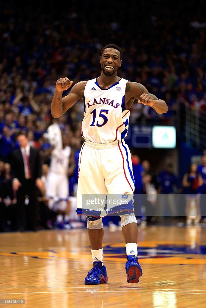 Elijah Johnson #15 of the Kansas Jayhawks celebrates after scoring during the game against the Texas Tech Red Raiders at Allen Fieldhouse on March 4, 2013 in Lawrence, Kansas.