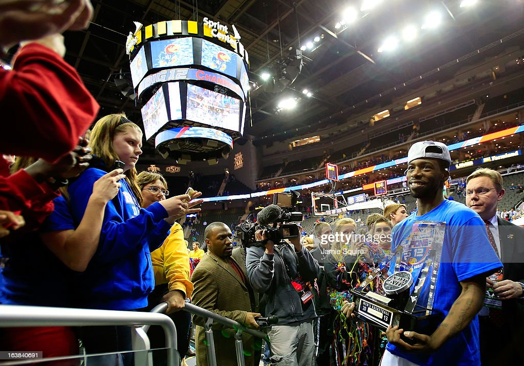 Elijah Johnson #15 of the Kansas Jayhawks celebrates their 70-54 win over Kansas State Wildcats during the Final of the Big 12 basketball tournament at Sprint Center on March 16, 2013 in Kansas City, Missouri.