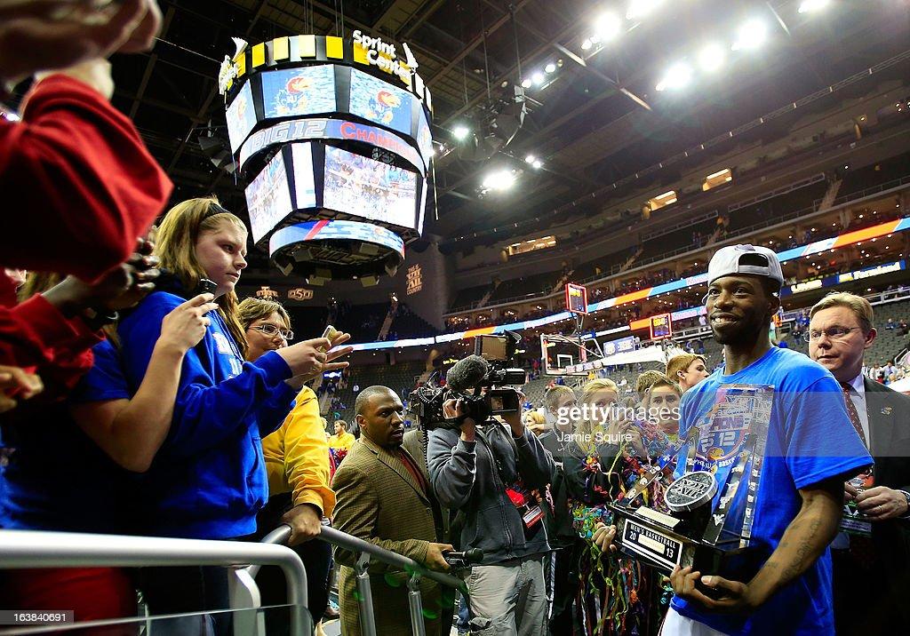 Elijah Johnson #15 of the Kansas Jayhawks celebrates their 70-54 win over Kansas State Wildcats during the Final of the Big 12 basketball tournament at Sprint Center on March 16, 2013 in Kansas City, Missouri.