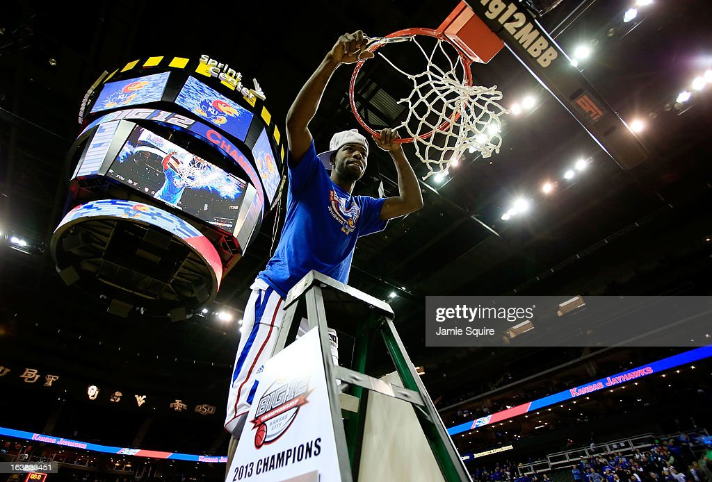 Elijah Johnson #15 of the Kansas Jayhawks cuts the net in celebration of their 70-54 victory over the Kansas State Wildcats during the Final of the Big 12 basketball tournament at Sprint Center on March 16, 2013 in Kansas City, Missouri.