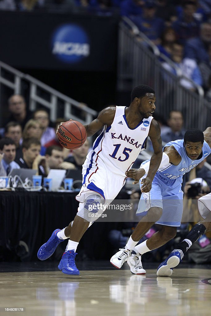 Elijah Johnson #15 of the Kansas Jayhawks drives to the goal against <a gi-track='captionPersonalityLinkClicked' href=/galleries/search?phrase=Dexter+Strickland&family=editorial&specificpeople=5792010 ng-click='$event.stopPropagation()'>Dexter Strickland</a> #1 of the North Carolina Tar Heels during the third round of the 2013 NCAA Men's Basketball Tournament at the Sprint Center on March 24, 2013 in Kansas City, Missouri.