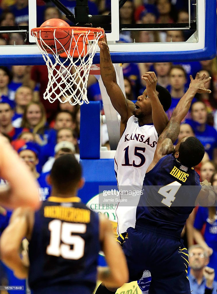 Elijah Johnson #15 of the Kansas Jayhawks dunks over Jabarie Hinds #4 of the West Virginia Mountaineers during the game at Allen Fieldhouse on March 2, 2013 in Lawrence, Kansas.