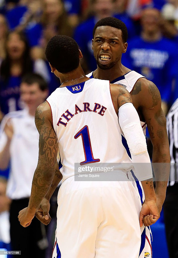 Elijah Johnson #15 of the Kansas Jayhawks is congratulated by <a gi-track='captionPersonalityLinkClicked' href=/galleries/search?phrase=Naadir+Tharpe&family=editorial&specificpeople=8624195 ng-click='$event.stopPropagation()'>Naadir Tharpe</a> #1 after scoring during the game against the West Virginia Mountaineers at Allen Fieldhouse on March 2, 2013 in Lawrence, Kansas.
