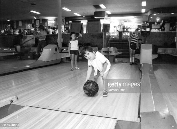 Elijah Kaplan tries to roll ball as sister Leora and brother Judah watch Instruction and organized leagues for children 8 and younger have boosted...