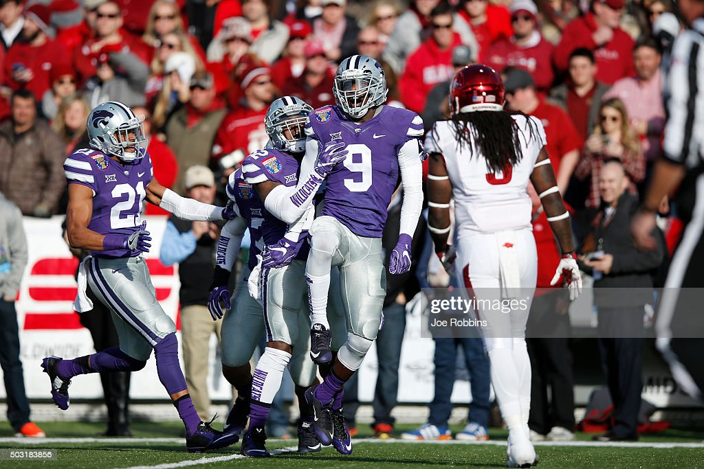 Elijah Lee of the Kansas State Wildcats celebrates with teammates after an interception against the Arkansas Razorbacks in the first quarter of the...