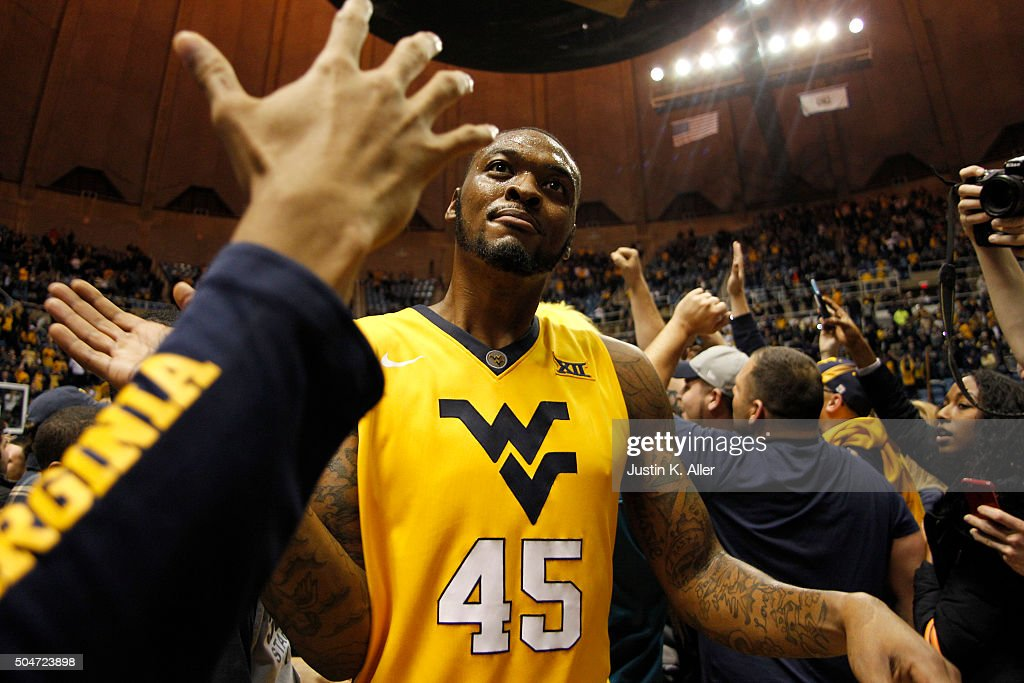 Elijah Macon of the West Virginia Mountaineers celebrates with students after upsetting the Kansas Jayhawks 7463 at the WVU Coliseum on January 12...