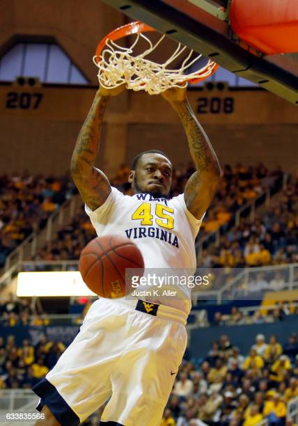 Elijah Macon of the West Virginia Mountaineers dunks the basketball against the Oklahoma State Cowboys at the WVU Coliseum on February 4 2017 in...