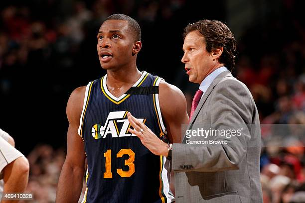Elijah Millsap and Quin Snyder of the Utah Jazz speak during a game against the Portland Trail Blazers on April 11 2015 at the Moda Center Arena in...