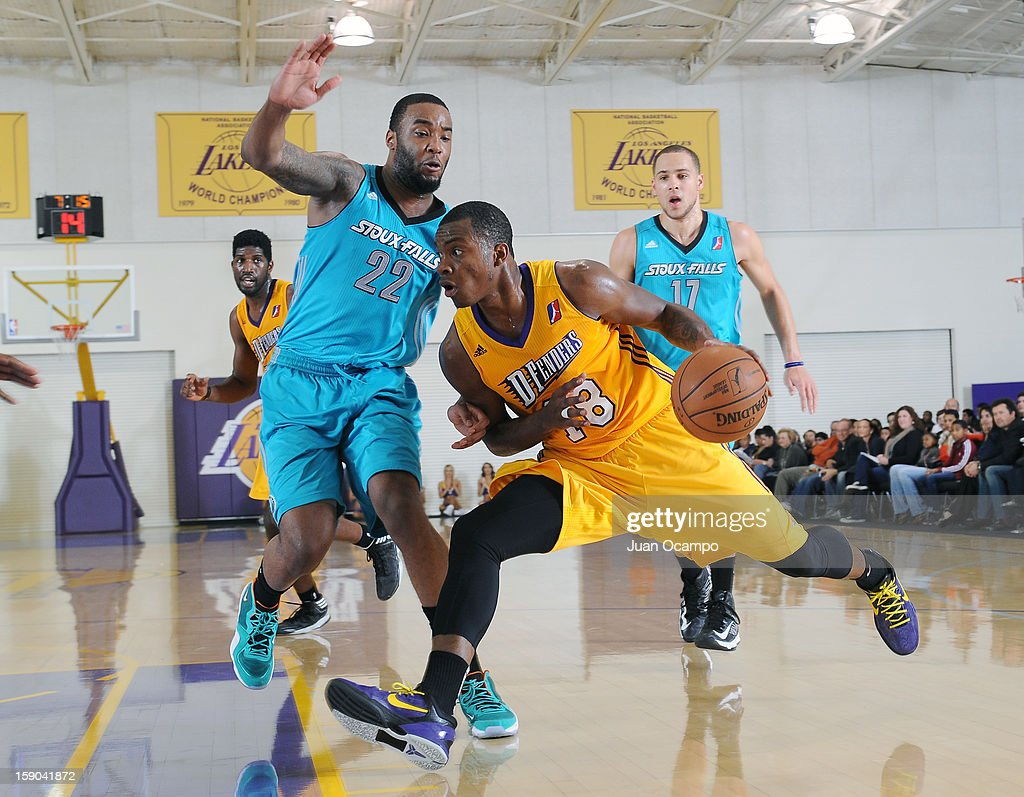 Elijah Millsap #18 of the Los Angeles D-Fenders drives to the basket against Arnett Moultrie #22 of the Sioux Falls Skyforce on January 5, 2013 at Toyota Sports Center in El Segundo, California.