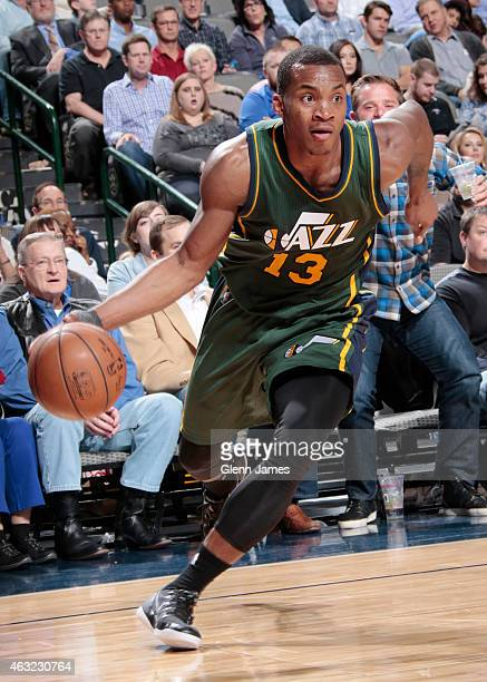 Elijah Millsap of the Utah Jazz drives against the Dallas Mavericks on February 11 2015 at the American Airlines Center in Dallas Texas NOTE TO USER...