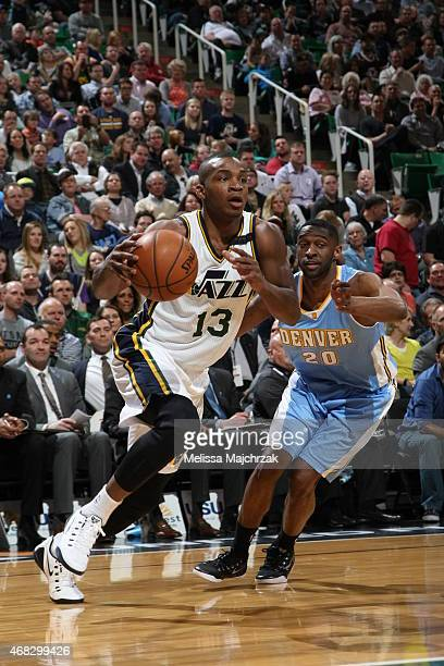 Elijah Millsap of the Utah Jazz drives to the basket against Ian Clark of the Denver Nuggets on April 1 2015 at EnergySolutions Arena in Salt Lake...