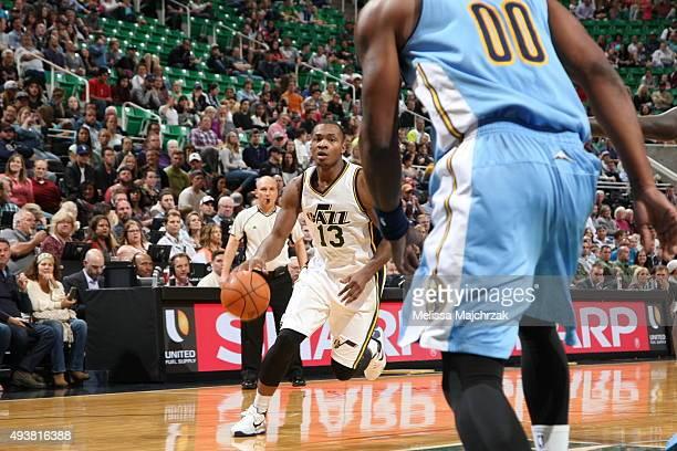 Elijah Millsap of the Utah Jazz drives to the basket against the Denver Nuggets on October 22 2015 at EnergySolutions Arena in Salt Lake City Utah...