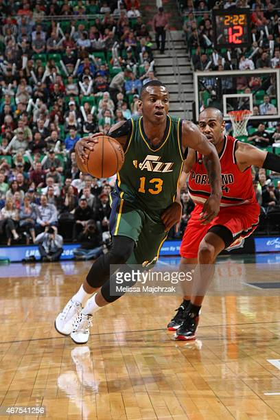 Elijah Millsap of the Utah Jazz drives to the basket against the Portland Trail Blazers on March 25 2015 at EnergySolutions Arena in Salt Lake City...