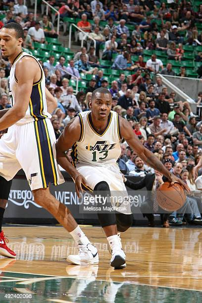 Elijah Millsap of the Utah Jazz drives to the basket against the Portland Trail Blazers during a preseason game at EnergySolutions Arena on October...