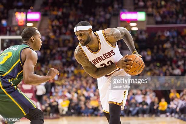 Elijah Millsap of the Utah Jazz puts pressure on LeBron James of the Cleveland Cavaliers during the second half at Quicken Loans Arena on January 21...
