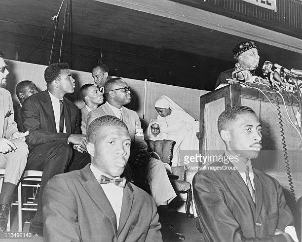 Elijah Muhammad Converted to Islam in 1931 from 1934 until his death be was leader of the Nation of Islam Here in 1964 addressing followers including...