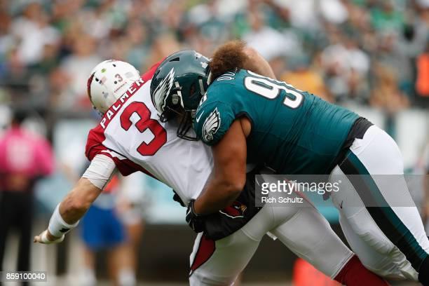 Elijah Qualls of the Philadelphia Eagles tackles quarterback Carson Palmer of the Arizona Cardinals during the second half at Lincoln Financial Field...