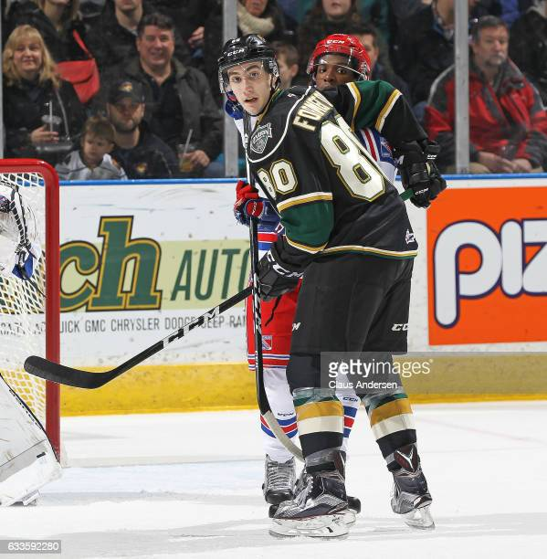 Elijah Roberts of the Kitchener Rangers looks to tie up Alex Formenton of the London Knights during an OHL game at Budweiser Gardens on February 1...