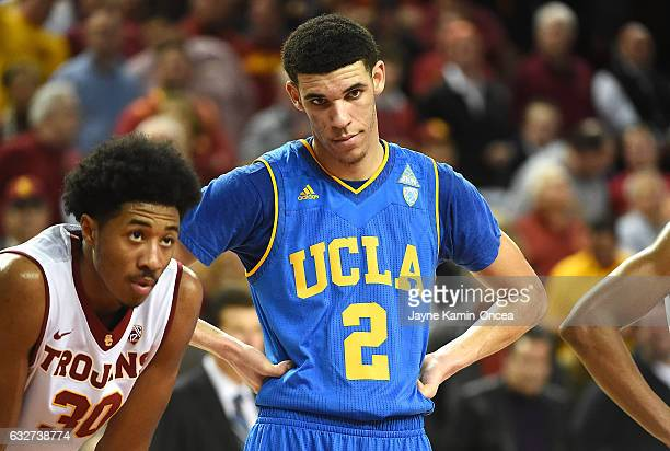 Elijah Stewart of the USC Trojans and Lonzo Ball of the UCLA Bruins wait for a free throw in the first half of the game at Galen Center on January 25...