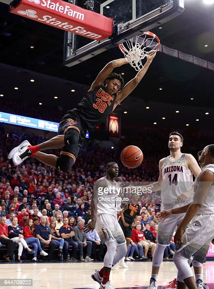 Elijah Stewart of the USC Trojans dunks the ball during the first half of the college basketball game against the Arizona Wildcats at McKale Center...