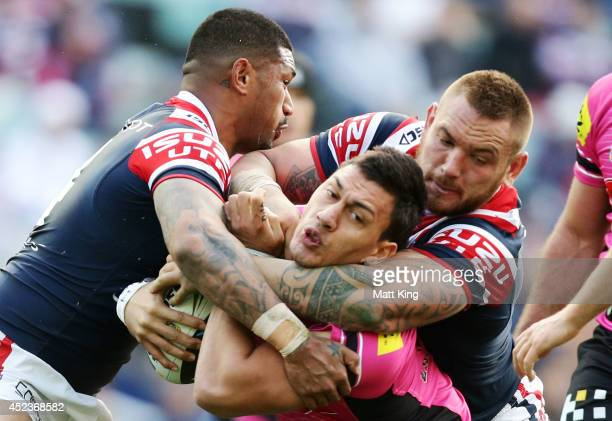 Elijah Taylor of the Panthers is tackled during the round 19 NRL match between the Sydney Roosters and the Penrith Panthers at Allianz Stadium on...