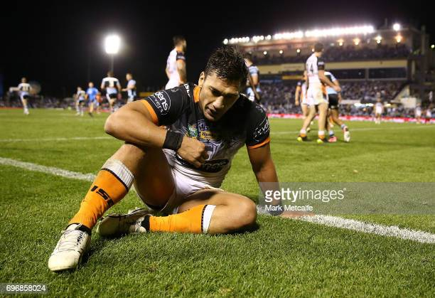 Elijah Taylor of the Tigers looks dejected after conceding a try during the round 15 NRL match between the Cronulla Sharks and the Wests Tigers at...
