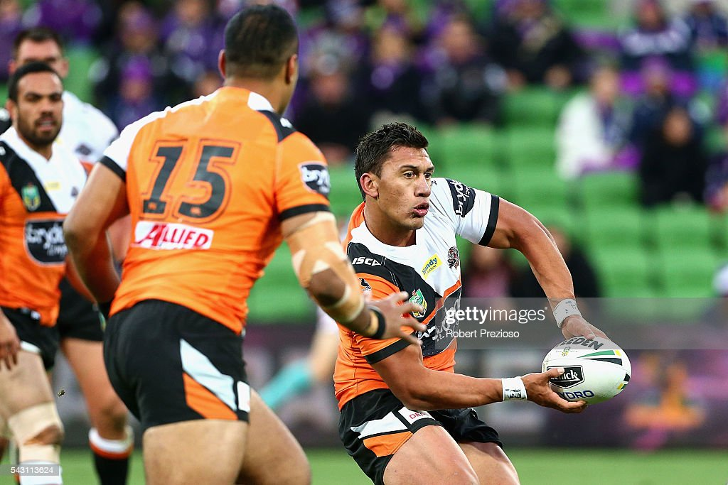 Elijah Taylor of the Tigers offloads during the round 16 NRL match between the Melbourne Storm and Wests Tigers at AAMI Park on June 26, 2016 in Melbourne, Australia.