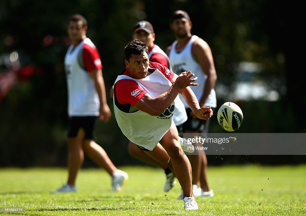 Elijah Taylor of the Warriors passes the ball during a New Zealand Warriors NRL training session at Mt Smart Stadium on February 14, 2013 in Auckland, New Zealand.