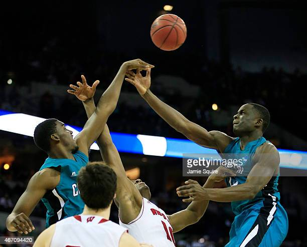 Elijah Wilson and Warren Gillis of the Coastal Carolina Chanticleers vie for posession with Nigel Hayes of the Wisconsin Badgers in the second half...