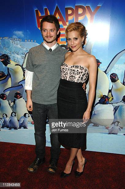 Elijah Wood and Brittany Murphy during 'Happy Feet' London Premiere Foyer Arrivals at Empire Leicester Square in London Great Britain