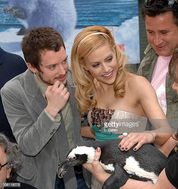 Elijah Wood and Brittany Murphy during 'Happy Feet' World Premiere Red Carpet at Grauman's Chinese Theatre in Hollywood California United States
