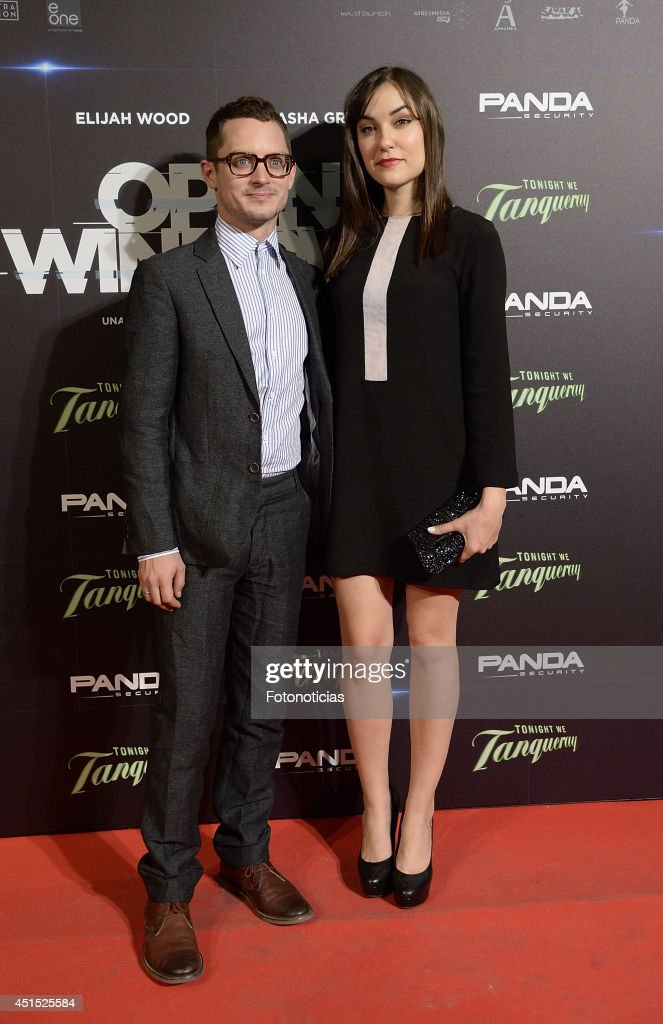 <a gi-track='captionPersonalityLinkClicked' href=/galleries/search?phrase=Elijah+Wood&family=editorial&specificpeople=171364 ng-click='$event.stopPropagation()'>Elijah Wood</a> and <a gi-track='captionPersonalityLinkClicked' href=/galleries/search?phrase=Sasha+Grey&family=editorial&specificpeople=4453354 ng-click='$event.stopPropagation()'>Sasha Grey</a> attend the 'Open Windows' premiere at Capitol cinema on June 30, 2014 in Madrid, Spain.