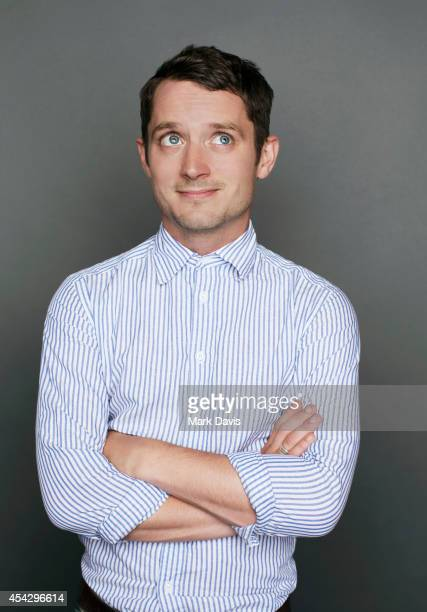 Elijah Wood poses for a portrait at The Theatre At The Ace Hotel on August 8 2014 in Los Angeles California