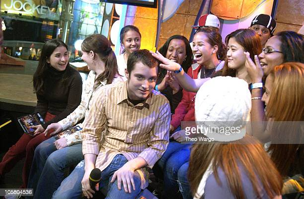 Elijah Wood with TRL audience members during The Cast of 'The Lord of the Rings' Visits MTV's 'TRL' November 19 2003 at MTV Studios Times Square in...