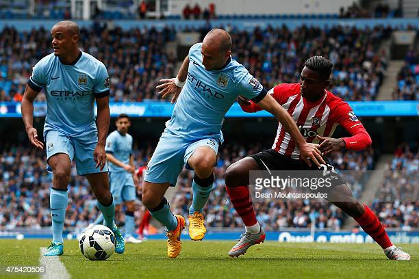 Elijero Elia of Southampton and Pablo Zabaleta of Manchester City battle for the ball during the Barclays Premier League match between Manchester...