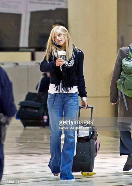 Elin Nordegren is seen at Los Angeles International Airport on February 16 2011 in Los Angeles California
