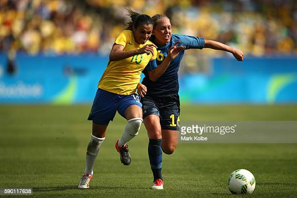 Elin Rubensson of Sweden and Marta of Brazil in action during the Women's Football Semi Final between Brazil and Sweden on Day 11 of the Rio 2016...