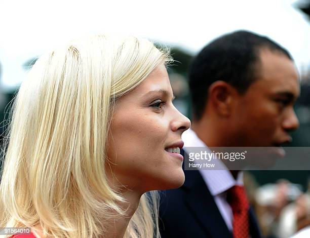 Elin Woods and husband Tiger Woods exit during Opening Ceremony of The Presidents Cup at Harding Park Golf Course on October 7 2009 in San Francisco...