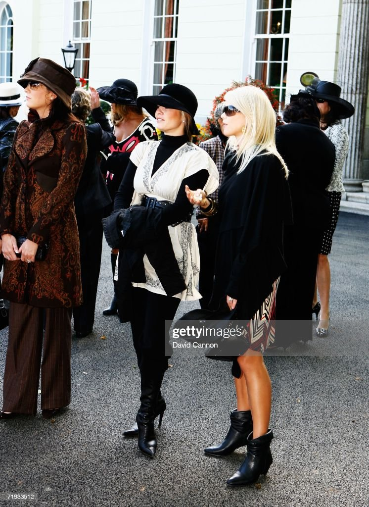 Elin Woods (R) looks on as USA and European team wives prepare to travel to The Curragh racecourse for the Wives Race Day prior to the start of the 2006 Ryder Cup at The K Club on September 19, 2006 in Straffan, Co. Kildare, Ireland.