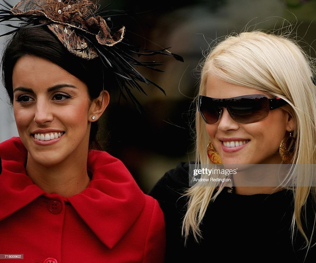 Elin Woods (R) wife of Tiger Woods, and Diane Antonopoulos (L) fiancee of Luke Donald, pose for a photograph during the Ryder Cup Wives Race Day at The Curragh racecourse on September 19, 2006 in Naas, Ireland.
