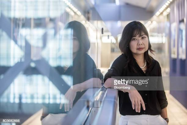 Elina Fung investment director of equities and fund manager at HSBC Asset Management Hong Kong Ltd poses for a photograph in Hong Kong China on...
