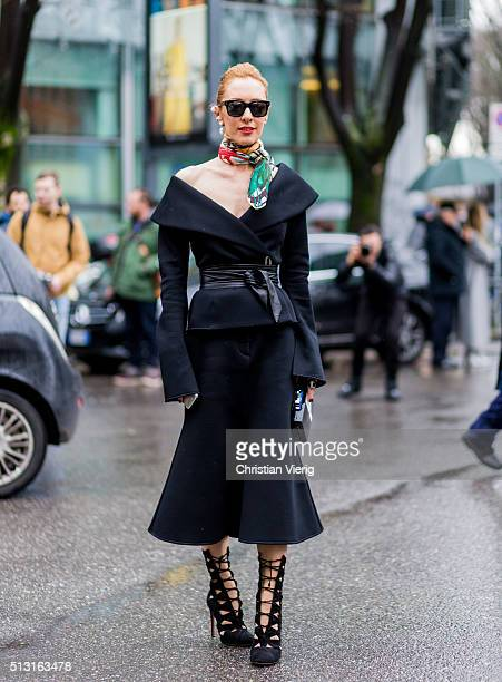 Elina Halimi is wearing a black dress seen outside Giorgio Armani during Milan Fashion Week Fall/Winter 2016/17 on February 29 in Milan Italy
