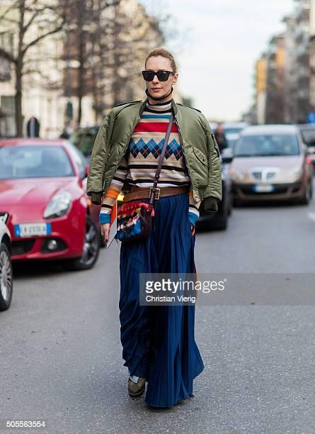 Elina Halimi outside Etro during Milan Men's Fashion Week Fall/Winter 2016/17 on January 18 in Milan Italy