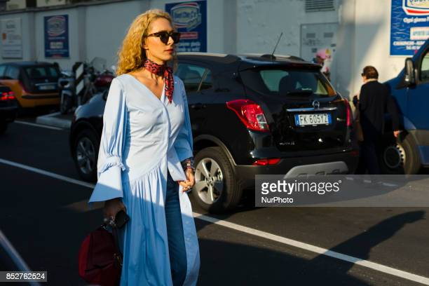 Elina Halimi wearing blue button dress denim jeans is seen outside Philosophy during Milan Fashion Week Spring/Summer 2018 on September 23 2017 in...