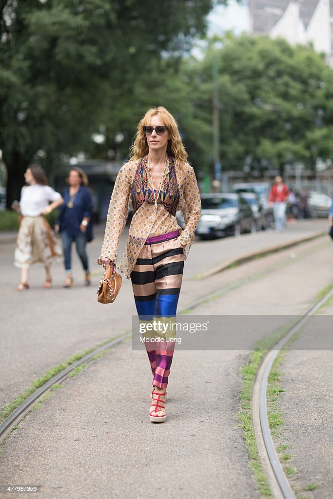 Elina Halimi wears Dries Van Noten a vintage bag and Saint Laurent vintage heels during Milan Men's Fashion Week Spring/Summer 2016 on June 20 2015...