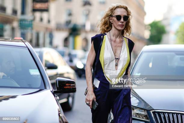 Elina Halimi wears sunglasses a low neck top and silk pants outside the Haider Ackermann show during Paris Fashion Week Menswear Spring/Summer 2018...