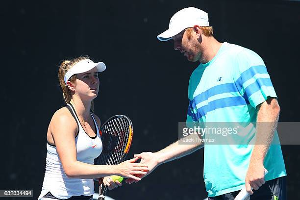 Elina Svitolina of the Ukraine and Chris Guccione of Australia compete in their first round match against AnnaLena Groenefeld of Germany and Robert...
