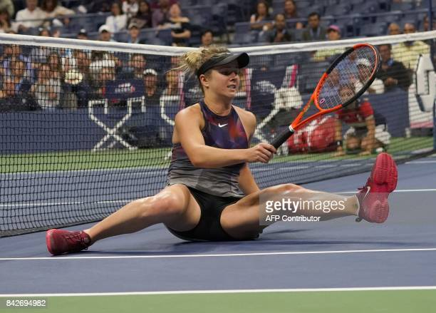 Elina Svitolina of the Ukraine falls down on the court while playing Madison Keys of the US during their fourth round 2017 US Open Women's Singles...